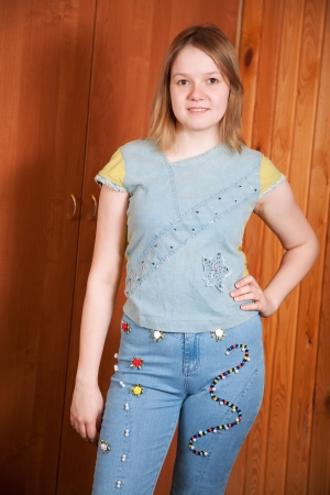 stitchcraft: girl shows a handmade cloth beaded by herself Stock Photo