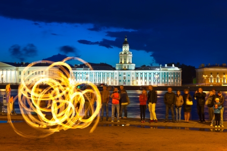 ST.PETERSBURG, RUSSIA - AUGUST 1:  Fire show in August 1, 2012 in St.Petersburg, Russia.Unidentified street performers show the fire show in night Neva embankment