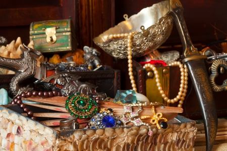 Few vintage treasure trunks with old jewellery Stock Photo - 15360343