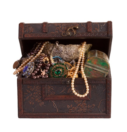 wooden treasure chest with valuables, isolated over white background Stock Photo