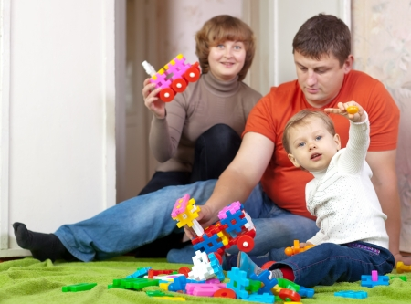 Family  plays with toys in home Stock Photo - 15360901