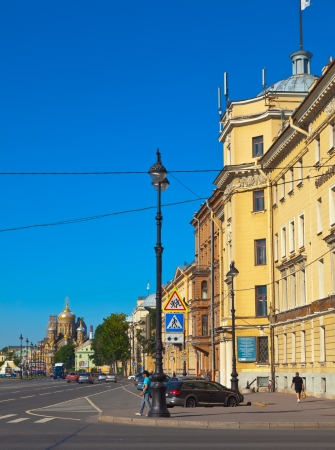 ST.PETERSBURG, RUSSIA - AUGUST 3: Street at Vasilyevsky Island in August 3, 2012 in St.Petersburg, Russia. Buildings of island began in mid 1710's. Now the district population of over 200 000 people Stock Photo - 15418579