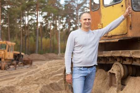 timber harvesting: Portrait of tractor operator at workplace