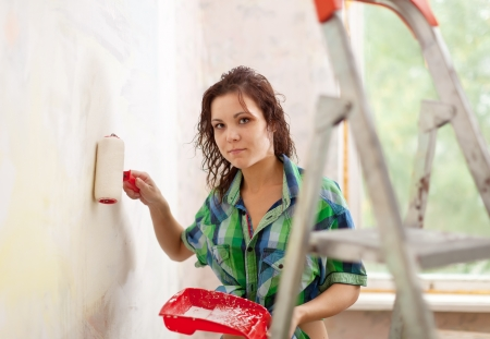modifying: Woman makes repairs in the apartment
