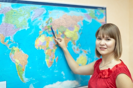 eastward: Woman showing something on the world map Stock Photo
