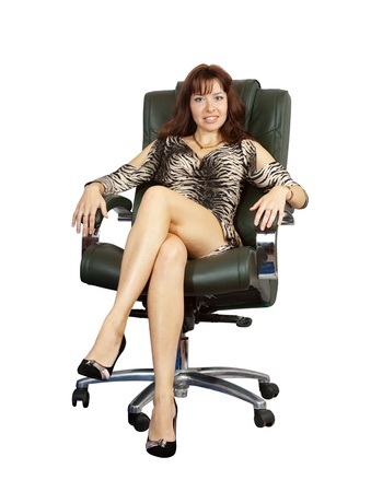 Business woman sitting on luxury office armchair. Isolated on white background photo