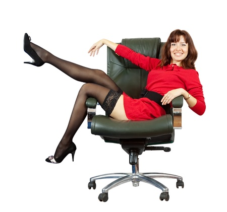 happy woman sitting on office armchair. Isolated on white background photo