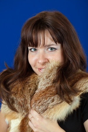 fox fur:  portrait of  girl in fox fur over blue background Stock Photo