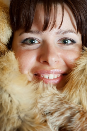 casualy: Portrait of happy girl in fox fur