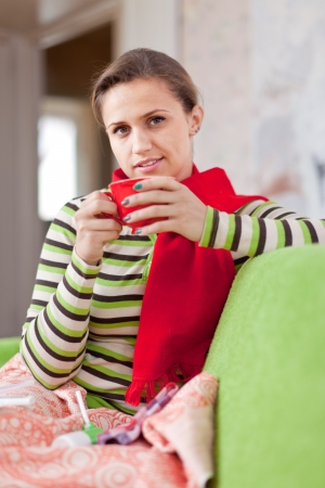 illness woman in warm scarf with hot cup Stock Photo - 15566035