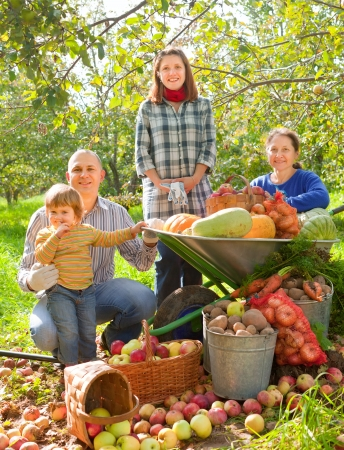 family gardening: Happy  family with vegetables harvest in garden