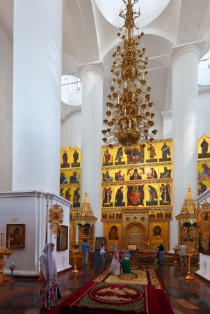believers: YAROSLAVL, RUSSIA - JULY 28: Assumption cathedral in July 28, 2012 in Yaroslavl, Russia. Assumption Cathedral was built in 1215 and demolished in 1937. From 2004 to present day are working to restore