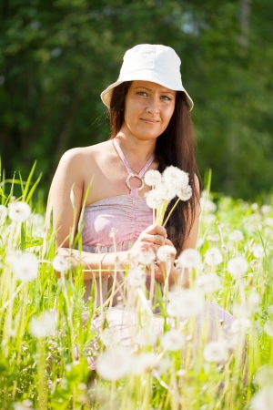 portrait of woman in dandelion plant Stock Photo - 15640675