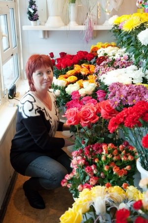 Female florist in her small  flower shop Stock Photo - 15640697