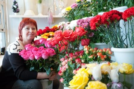 proprietor: Female florist in her small  flower shop Stock Photo