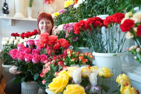 sundry: woman in the store surrounded by different flowers
