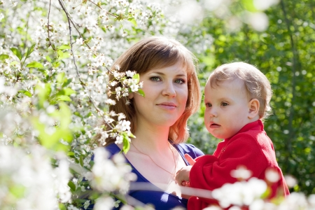 parentage: Happy family  in spring blossoming garden