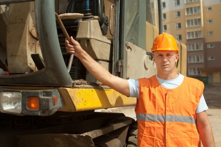 Portrait of tractor operator at construction site  photo