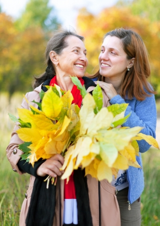 Happy  mature woman with adult daughter in autumn  park Stock Photo - 15752830