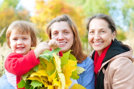 20 23 years: Portrait of three generations in the autumn park
