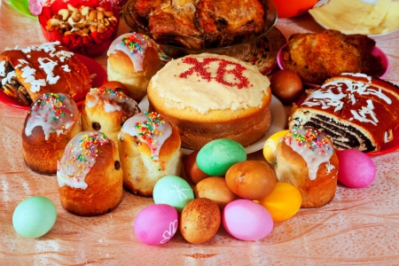 russian easter: Easter cakes and other meal on festive table