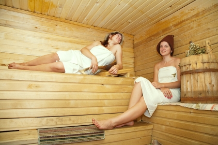 stive: Young women is taking steam-bath  at sauna  Stock Photo