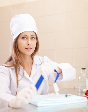 Positive young nurse with tourniquet in medical laboratory Stock Photo - 15753329