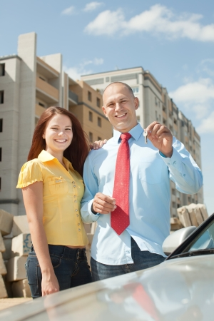 residential settlement: Outdoor portrait of   happy couple against real estate Stock Photo