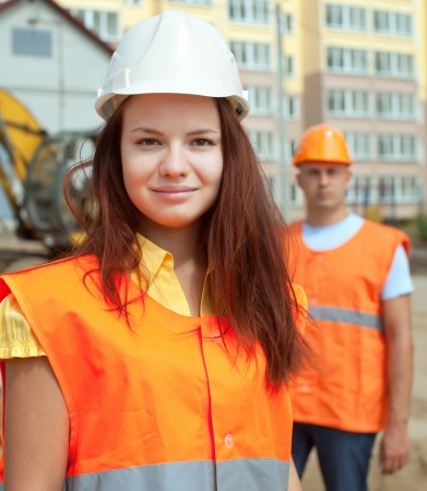 new employee: Portrait of two builders standing at building site  Stock Photo