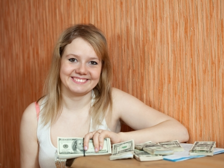 happy casual girl with US dollars  in home inter Stock Photo - 15806953
