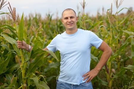 old farmer: man standing in field of corn