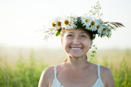 chaplet: happy mature  woman in  camomile chaplet