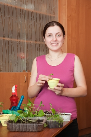 Female gardener with various seedlings at home Stock Photo - 15870345