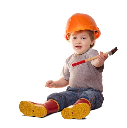 Toddler in hardhat with hammer. Isolated over white background  with shade photo