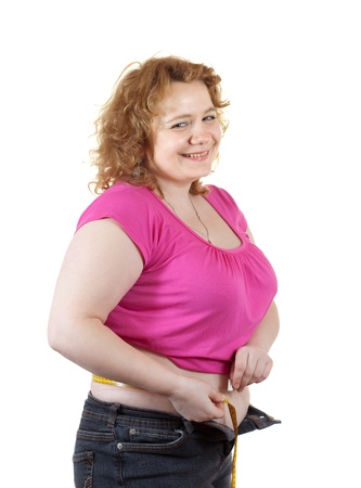 fat unsightly woman measuring waist with tape measure. Isolated over white background photo