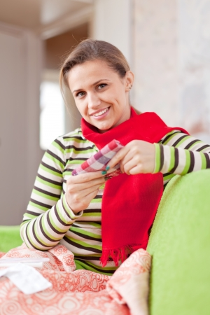 convalesce: sick woman uses handkerchief in home Stock Photo