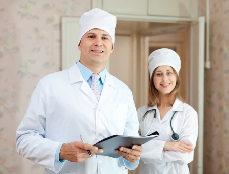 Portrait of doctor and nurse in clinic interior. Focus on man photo