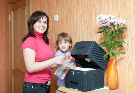 mother and daughter uses humidifier at home  photo