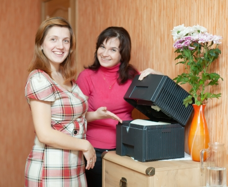 humidifier: Two women uses humidifier  at home   Stock Photo