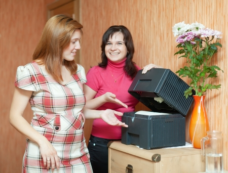 humidifier: Two women uses humidifier  at home
