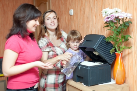 ionizing: Two women and girl uses humidifier  at home