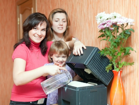 Two women and girl uses humidifier  at home  photo