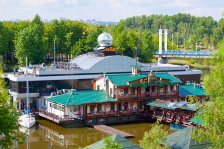 12th century: YAROSLAVL, RUSSIA - JULY 28: Entertainment complex on water in July 28, 2012 in Yaroslavl,  Russia.City was founded in 12th century. Historic city center is World Heritage Site. Population - 591,374