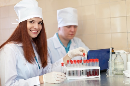 scientific workers with test tubes in laboratory Stock Photo - 16057944