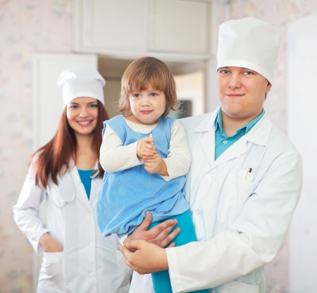Doctor and nurse with child at medical clinic Stock Photo - 16057877