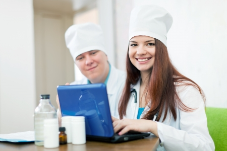 two doctors with laptop in clinic interior photo