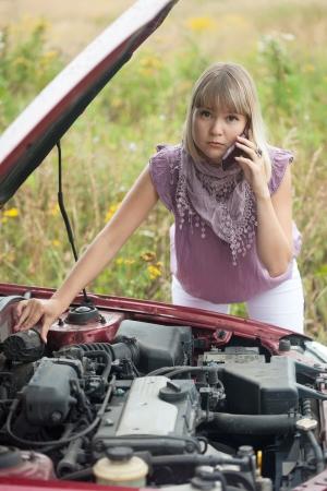 Woman waiting support near  her broken car photo