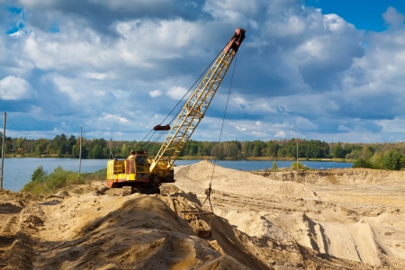 sand pit: machinery at sand pit in sunny day