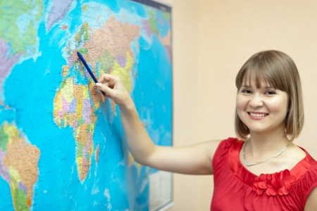 eastward: Woman showssomething on the worldmap at house