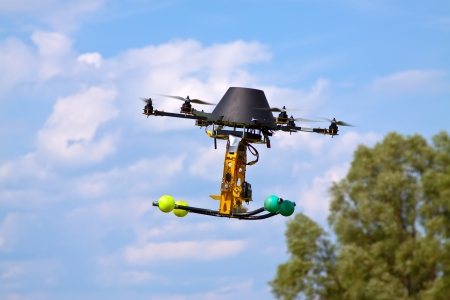 controlled: remote controlled flying craft with four motors Stock Photo